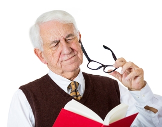 Image of man having difficulty reading